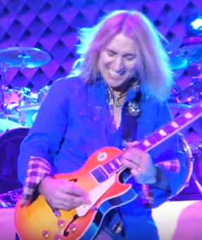 August Zadra performing with Dennis DeYoung